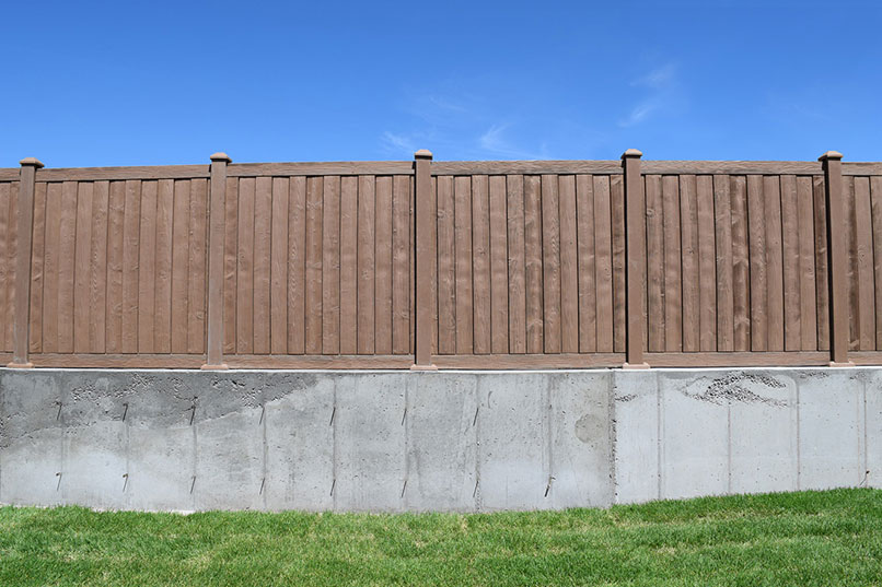 Ashland Red Cedar Privacy Fence Panels on Concrete Wall