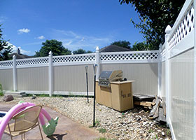 white fence with lattice