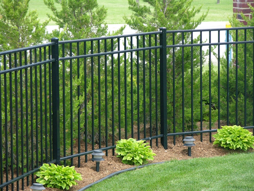 Decorative Gold Picket Picket caps with circle center and black aluminum fence