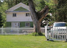 Olympia Arched White Vinyl Picket Fence
