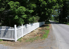 Olympia Arched Tan Vinyl Picket Fence