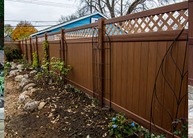 mocha walnut wood grain privacy fence