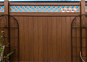 mocha walnut privacy fence with lattice top