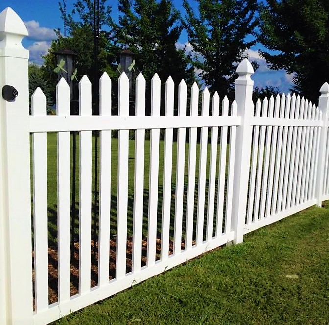 Olympia style white picket fence with gothic post caps