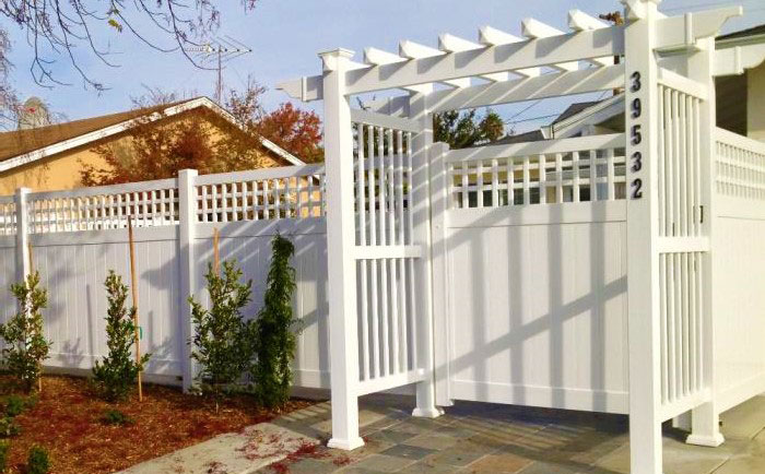 White vinyl fence with straight top arbor