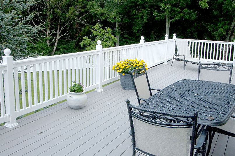 A deck with white fence