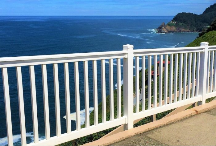A white vinyl railing for a property near the ocean