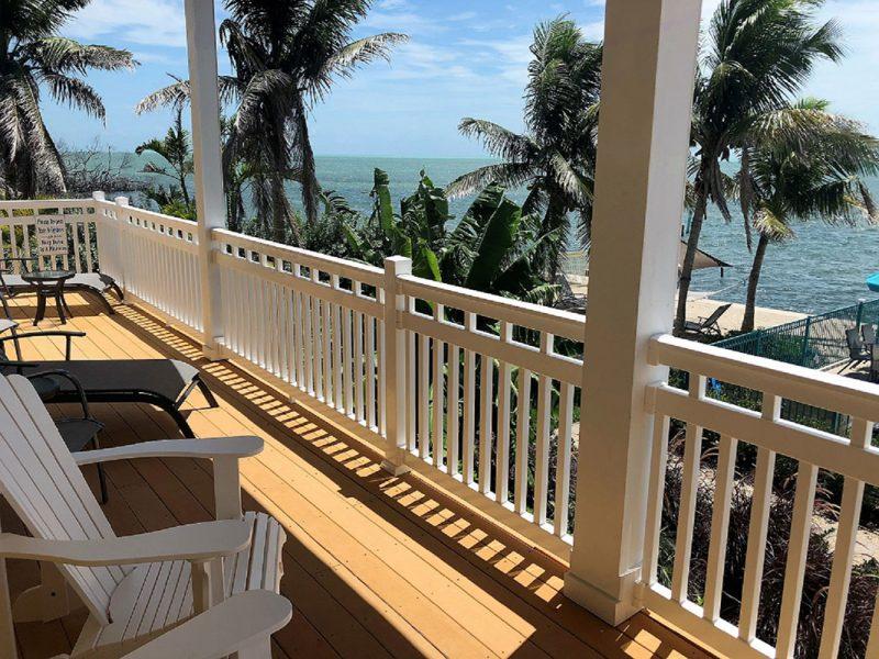 White vinyl railing on a deck on a home near the beach