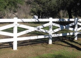 white crossbuck fence