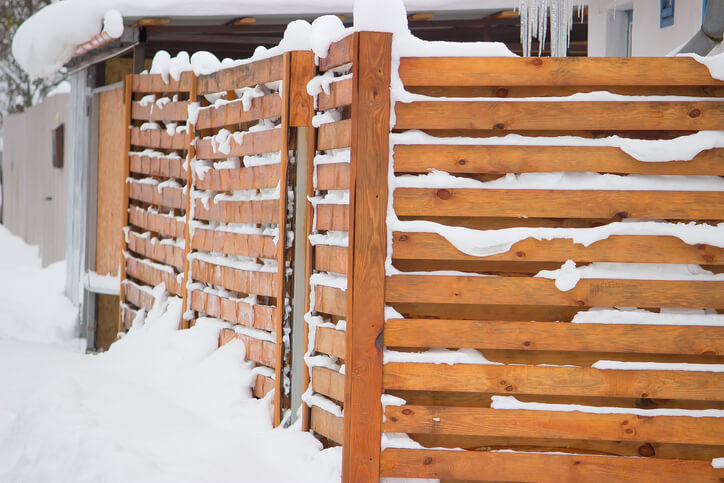 Snow covered wooden fence