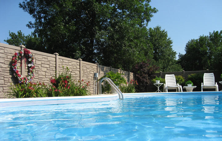 A SimTex EcoStone Simulated Stone fence installed around a private pool