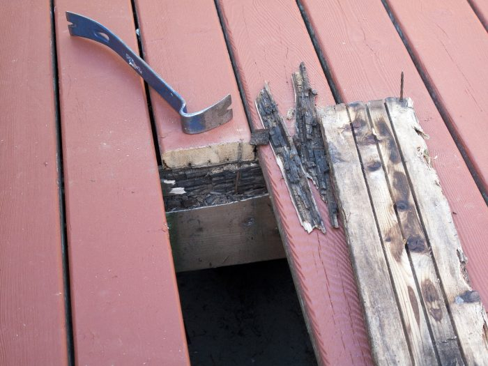 A wooden board pulled from a wooden deck because of rot