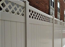 Tan privacy fence with lattice top